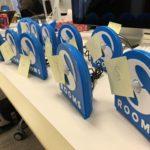 """Twelve """"SPR Rooms"""" sensors housed in blue 3D printed casings sitting on a table"""