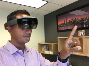Naresh Koka using a Microsoft HoloLens