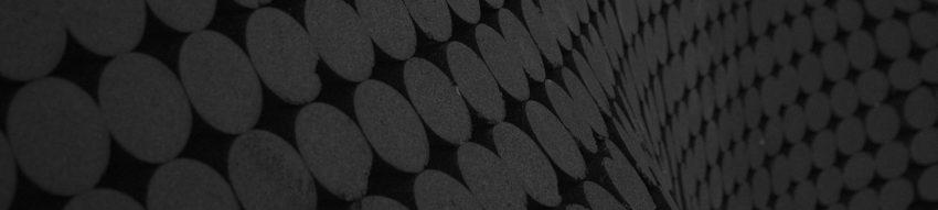 Dark gray circles on a black curving background